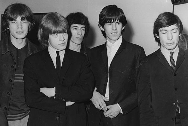 rolling stones relationship with the beatles