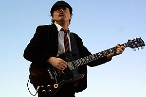 an analysis of the topic of angus young guitarist of acdc The years appear to have have caught up with ac/dc guitarist angus young, 60, as he watched the french open on wednesday.